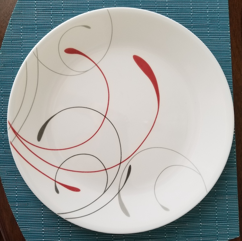 Corelle large plate - of a set - with red and grey swirly pattern