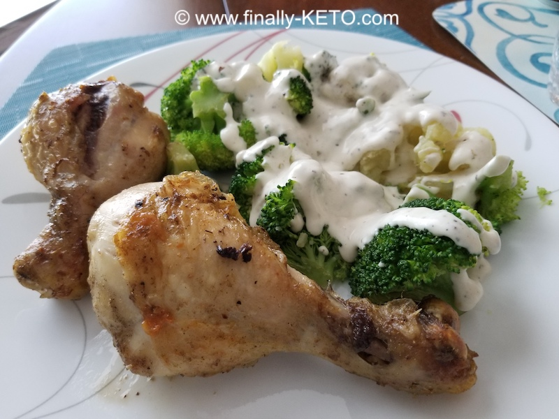 Two tasty Chicken Drumsticks with Broccoli and Cauliflower - with Alfredo Sauce