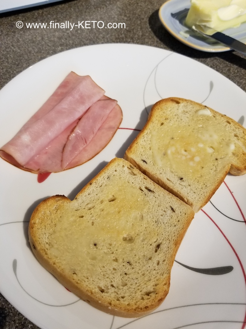 ThinSlim Foods Rye bread, toasted next to a slice of Target Black Forest Ham